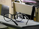 glasses on a school desk 130 x97